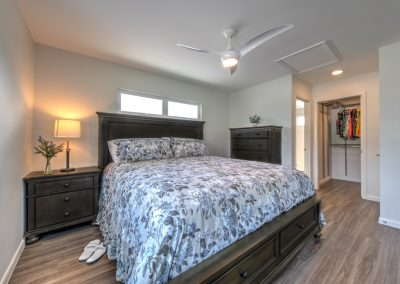 The bedroom is strategically tucked to the side of the living room, positioned away from the busy street corner.