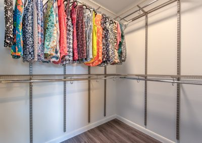 The full-sized walk-in closet has adjustable height racks for accessibility.